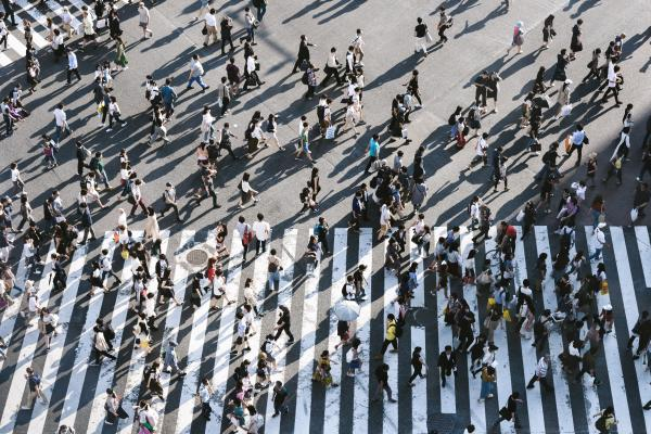 Photo of a large group of people crossing a road
